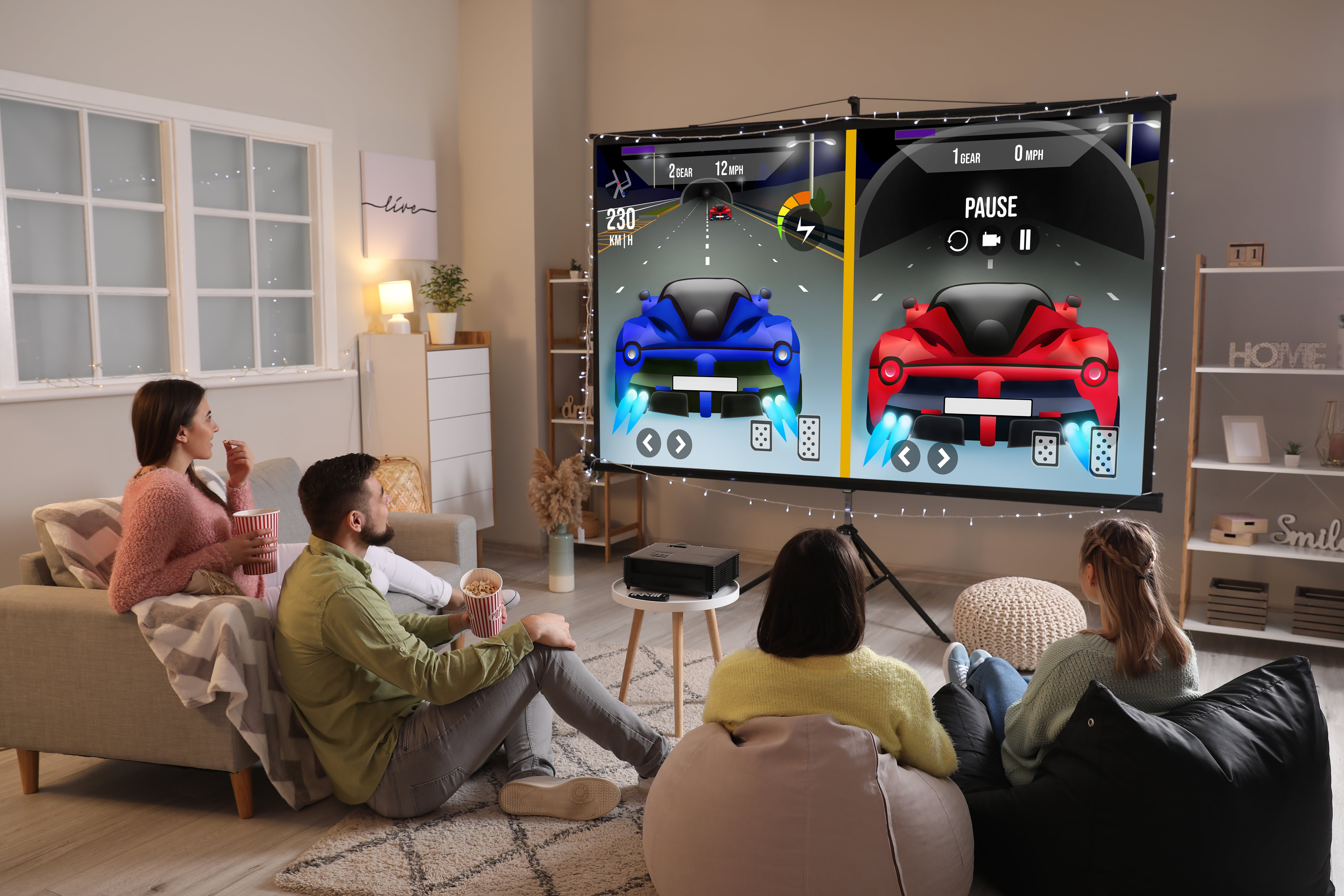 4 Gamers playing and a gaming projector at home