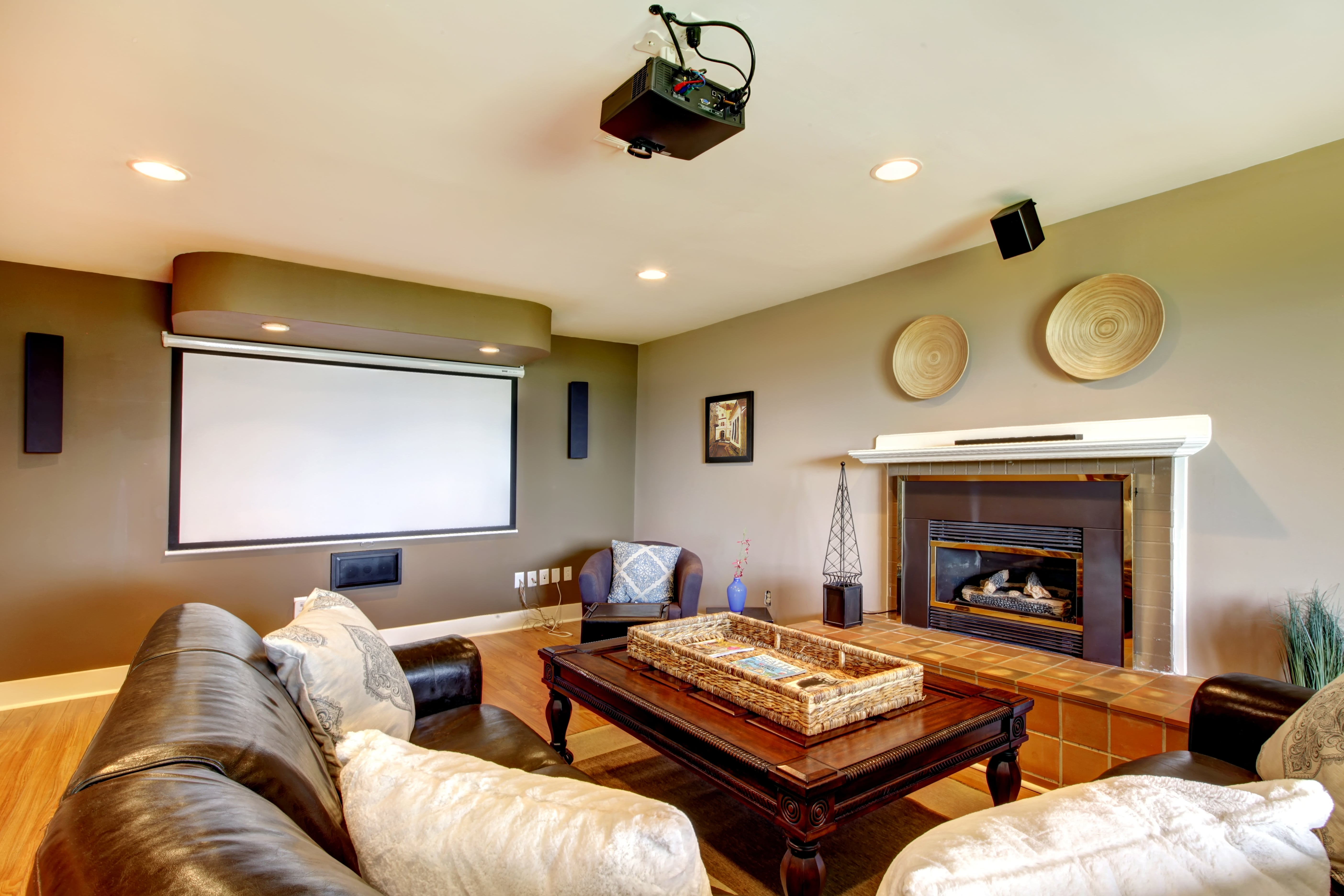 Living room with a projector and a fireplace